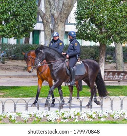 MADRID, SPAIN - MAR 4, 2014: Horse police on the Plaza de Espana (Spain Square), Madrid, Spain. Plaza de Espana is a popular touristic destination in Madrid