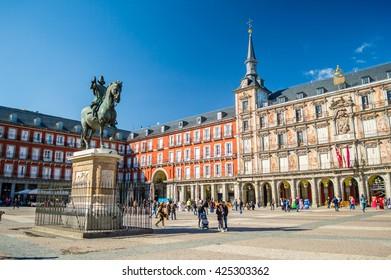 MADRID, SPAIN - March 03, 2016: Felipe III statue and Casa de la Panaderia on Plaza Mayor in Madrid, Spain