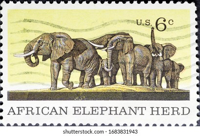 MADRID, SPAIN - MARCH 13, 2020. Vintage stamp printed in United States shows African Elephant herd