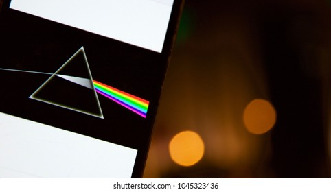MADRID, SPAIN - MARCH 13: Pink Floyd's Dark Side of the Moon disc on a mobile phone with defocused Bokeh effect background on March 13, 2018 in Madrid, Spain.