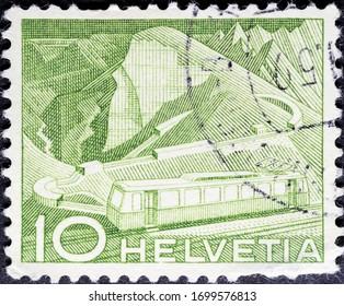 MADRID, SPAIN - MARCH 15, 2020. Vintage stamp printed in Switzerland shows mountain railway at Rocher de Naye