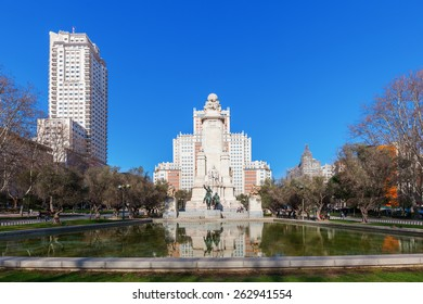 MADRID, SPAIN - MARCH 16, 2015: sculpture of famous characters Don Quixote and Sancho Panza in front of monument to Spanish novelist Miguel de Cervantes with unidentified people on the Plaza de Espana