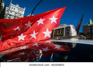 MADRID, SPAIN - MARCH 16, 2016.A taxi with the flag of Madrid during a demonstration of taxi drivers against private services such us Uber and Cabify.