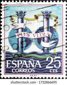 MADRID, SPAIN - MARCH 18, 2020. Vintage stamp printed in Spain shows the Pillars of Hercules bearing the motto Plus ultra, the national motto of Spain, following the discovery of the New World
