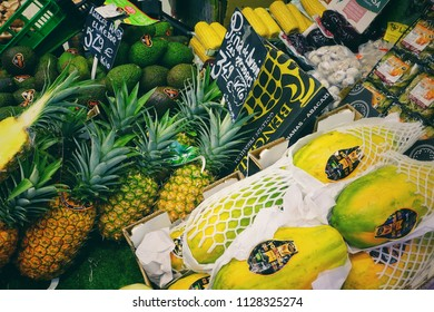 MADRID, SPAIN - MARCH 23, 2018: The range of fresh pineapples and melons in the store