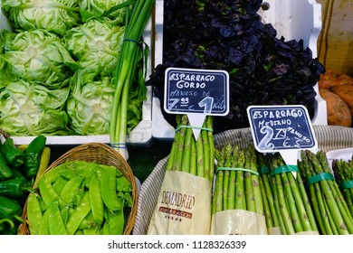 MADRID, SPAIN - MARCH 23, 2018: The range of fresh asparagus, beans, cabbage in the store