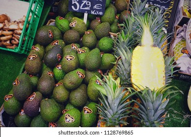 MADRID, SPAIN - MARCH 23, 2018: The range of fresh avocados and pineapples in the store