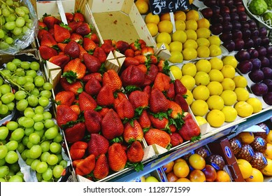 MADRID, SPAIN - MARCH 23, 2018: The range of fresh strawberry, grapes, nectarines, plums in the store