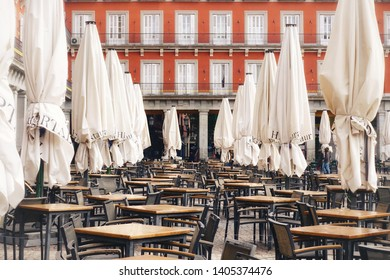 MADRID, SPAIN - MARCH 24, 2018: Cafe on Plaza Mayor. Plaza Mayor one of central squares of the Spanish capital.