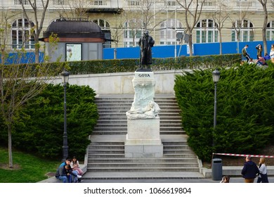 MADRID, SPAIN - March 25, 2018: Unknown people walking at the famous monument to Goya. It is facing the North facade of Museum Prado, so-called Goya's Door.