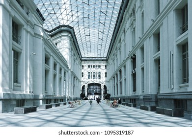 MADRID, SPAIN - MARCH 26, 2018: Unknown people walking in the Glass Gallery (Cibeles Palace) in Madrid. Madrid is a popular touristic city.
