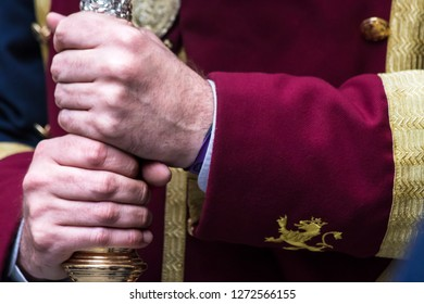 MADRID, SPAIN - MARCH 28, 2018: Holy Week processions in MADRID. Hands of penitent holding the banner of the Christ of the Gypsies
