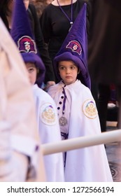 MADRID, SPAIN - MARCH 28, 2018: Holy Week processions in MADRID. Children dressed as Nazarenes in the procession of the Christ of the Gypsies