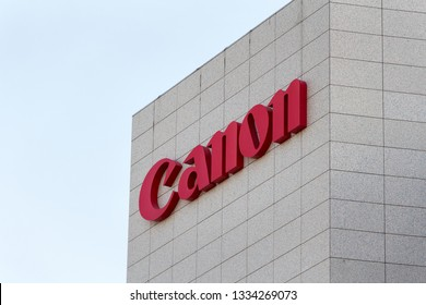 MADRID, SPAIN - MARCH 9, 2019. Canon logo on Canon building. Canon is a Japanese multinational corporation specializing in the manufacture of imaging and optical products