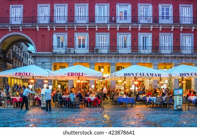 MADRID, SPAIN - MAY 09, 2016 : Unknown tourists at restaurant on Mayor Plaza in Madrid, Spain.