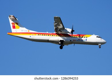 MADRID / SPAIN - MAY 1, 2016: Iberia Regional Air Nostrum ATR-72 EC-LSQ passenger plane landing at Madrid Barajas Airport