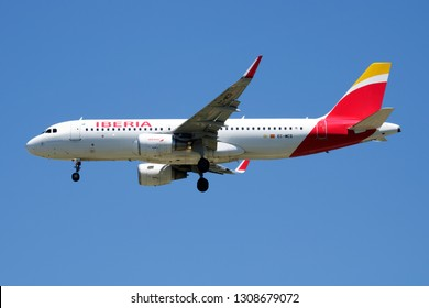 MADRID / SPAIN - MAY 1, 2016: Iberia Airlines Airbus A320 EC-MCS passenger plane landing at Madrid Barajas Airport