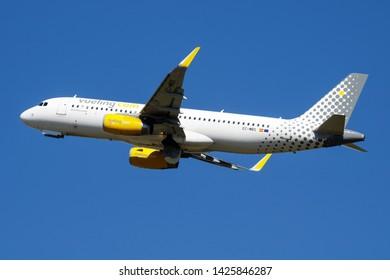 MADRID / SPAIN - MAY 1, 2016: Vueling Airbus A320 EC-MBS passenger plane departure at Madrid Barajas Airport