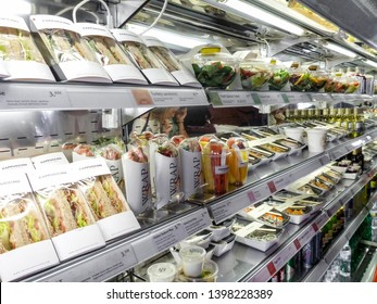 Madrid, Spain - May 10 2019 - Bad habits of the human in modern times: shelf full of pre-packaged foods, ready to eat. Plastic abuse to contain ready-to-eat salads, sandwiches, fruit and vegetables.