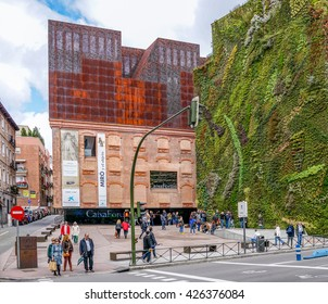 MADRID, SPAIN - MAY 12, 2016 :  Caixa Forum building by architect Herzog & De Miron and facade of plants by botanist Patrick Blanc in Madrid, Spain. It is most important modern building in Madrid.