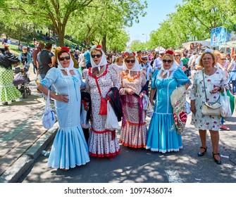 Madrid, Spain - May 15, 2018. Citizens dressed as Chulapas honours its patron, Saint San Isidro at festivity of San Isidro Labrador, in Pradera de San Isidro park of Madrid.