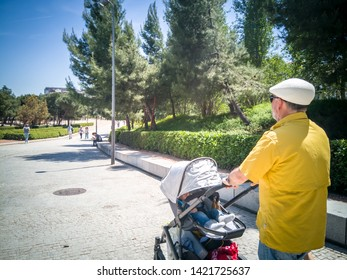 Madrid / Spain - May 15, 2019: Grandparents taken care of their grandkids in Madrid