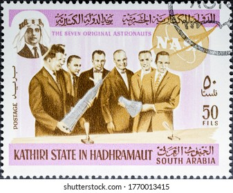MADRID, SPAIN - MAY 17, 2020. Vintage stamp printed in kathiri state shows the seven original American astronauts, Scott Carpenter, Gordon Cooper, John Glenn, Gus Grissom, Wally Schirra, Alan Shepard