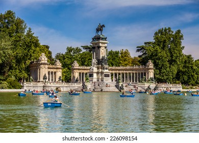 Madrid, Spain - May 18, 2014: people riding small boats at Parque del Buen Retiro