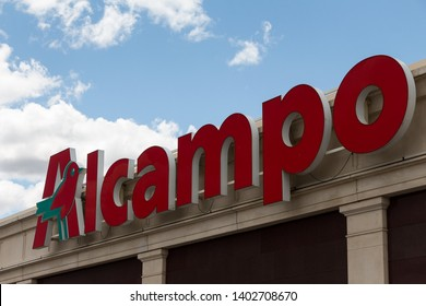 MADRID, SPAIN - MAY 18, 2019. Alcampo logo on Alcampo building. Alcampo is the name of the 2nd biggest hypermarket chain in Spain and part of Auchan group