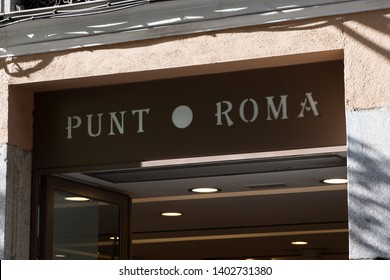 MADRID, SPAIN - MAY 19, 2019. Punt Roma logo on Punt Roma shop. Punt Roma is a spanish clothing company