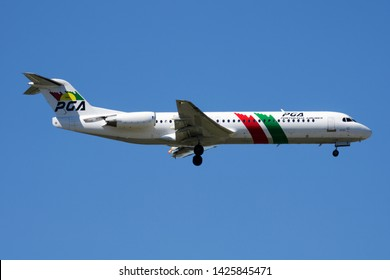 MADRID / SPAIN - MAY 2, 2016: PGA Portugalia Airlines Fokker 100 CS-TPF passenger plane landing at Madrid Barajas Airport