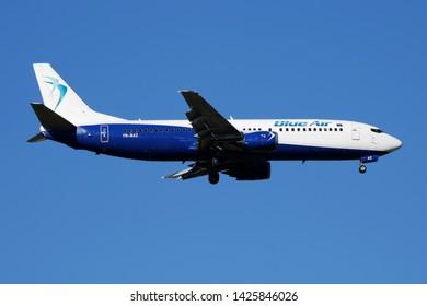 MADRID / SPAIN - MAY 2, 2016: Blue Air Boeing 737-400 YR-BAZ passenger plane landing at Madrid Barajas Airport