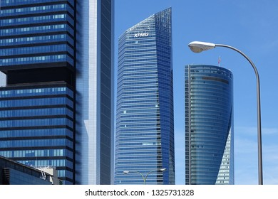 Madrid, Spain - May 20, 2017: Four modern skyscrapers in the Cuatro Torres Business Area. Crystal, Space, Pwc and CEPSA Towers are the tallest buldings in the country.