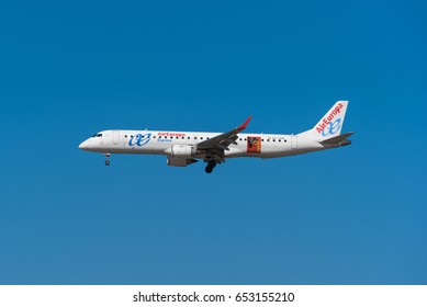 Madrid, Spain - May 22, 2017: Air Europa Embraer ERJ 195 LR is landing in Madrid Barajas airport on May 22, 2017. Air Europa is the a spanish airways company.