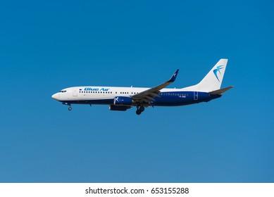 Madrid, Spain - May 22, 2017: Blue Air Boeing 737 85R is landing in Madrid Barajas airport on May 22, 2017. Blue Air is a low cost Rumanian airways company.