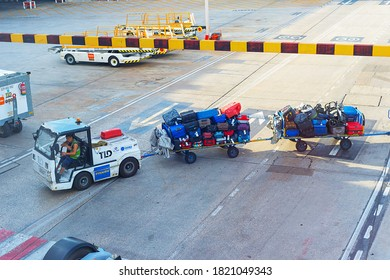 MADRID, SPAIN - MAY 23, 2017: Truck loaded with baggage from airplane at airport.