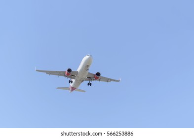 MADRID, SPAIN - MAY 23th 2015: Aircraft Airbus A320, of Iberia airline, is landing on Madrid - Barajas, Adolfo Suarez, airport, on May 23th 2015. Iberia express travels. Blue sky. Sunny day of spring.