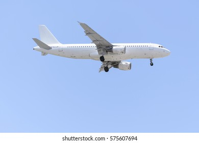 MADRID, SPAIN - MAY 23th 2015: Fully white plane Airbus A320, of SmartLynx Airlines airline, is landing on Madrid - Barajas, Adolfo Suarez, airport, on May 23th 2015. Charter flights. Blue sky.