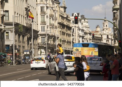 Madrid, Spain - May 27, 2016: Traffic of cars and busses and a red light in the Gran Via main street in Madrid, Spain on May 27, 2016