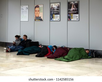 Madrid, Spain - May 28 2018. People are waiting for the flight. Flight delay.