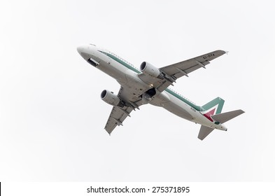 MADRID, SPAIN - MAY 3th 2015: Aircraft -Airbus A320-, of -Alitalia- airline, is taking off from Madrid-Barajas -Adolfo Suarez- airport, on May 3th 2015.