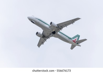 MADRID, SPAIN - MAY 3th 2015: Aircraft Airbus A320, of Alitalia airline, is taking off from Madrid-Barajas Adolfo Suarez airport, on May 3th 2015. Cloudy day of spring.