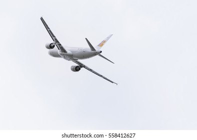 MADRID, SPAIN - MAY 3th 2015: Back view of aircraft Airbus A320, of Iberia airline, taking off from Madrid-Barajas Adolfo Suarez airport, on May 3th 2015. Cloudy day of spring.