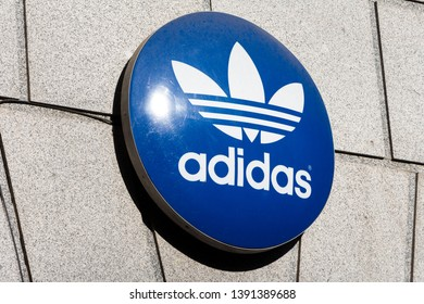 MADRID, SPAIN - MAY 5, 2019.  Adidas logo on Adidas store. Adidas is a german company that designs and manufactures shoes, clothing and accessories