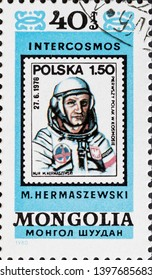 MADRID, SPAIN - MAY 5, 2019. Vintage stamp printed in Mongolia shows Mirosław Hermaszewski, a retired Polish Air Force officer and cosmonaut