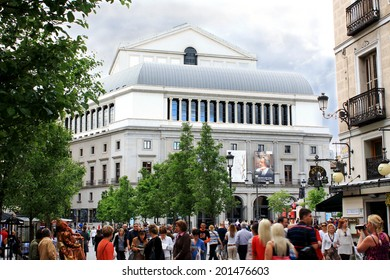 MADRID, SPAIN - MAY 9, 2013 : People walking on the Arenal street on the background of the Royal Opera House.