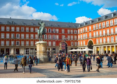 MADRID, SPAIN - NOV 07, 2016: People at the Mayor Plaza with the statue of King Philips III in Madrid