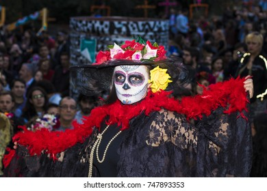 MADRID SPAIN - NOV 1 Young girl made up as a Mexican Catrina on the streets of Madrid in the celebration of the Mexican Day of the Dead on November 1, 2017 in Madrid