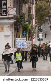Madrid, Spain; Nov 11, 2018: Protest Against Racism. Protesters holding a banner going to gather for the demonstration against racist politics.