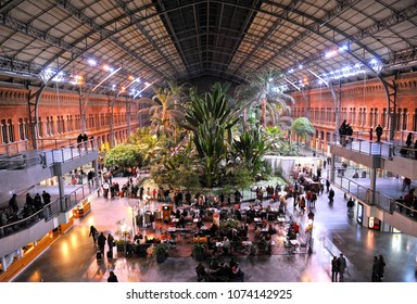 Madrid, Spain - Nov 21, 2011: Hall of Atocha train station by night, Madrid, Spain. Atocha is the station that connects Madrid by train with the south and east of Spain